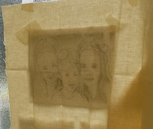 embroidered portrait on the window